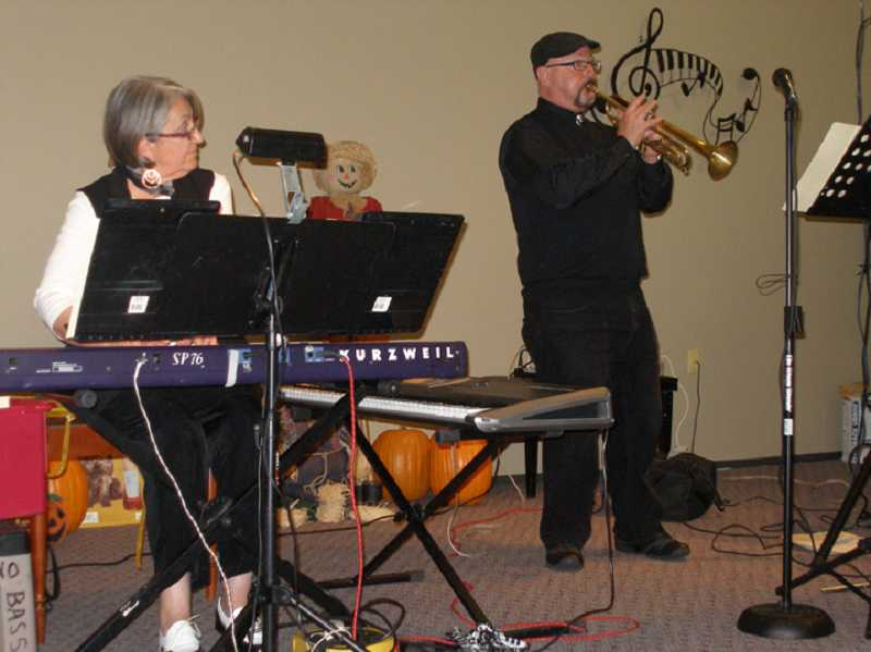 by: COURTESY OF SUZANNE SHORT - MAKING MUSIC AS A DUO - Suzanne Short, who plays the keyboard while Brad Davis plays the trumpet when they perform as a duo, are starting up the New Horizons Big Band in September.