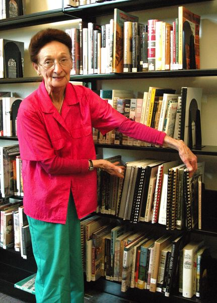 by: ISABEL GAUTSCHI - Historian Kathryn Hurd measures off the volumes on Estacada history in the library. With little documentation on Estacada's history to be found, Hurd has had to rely heavily on oral remembrances of the past to piece together what the Estacada area was like in times past. Hurd will give a talk on the history of the Estacada Public Library at the library centennial celebration on Saturday, Sept. 7.