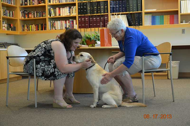 by: CHRIS CASEBEER/FOR THE REGAL COURIER - HELLO AND GOODBYE - Beth Allred (left) and Lou Travis will always share a bond through the dog they both love, Paige.