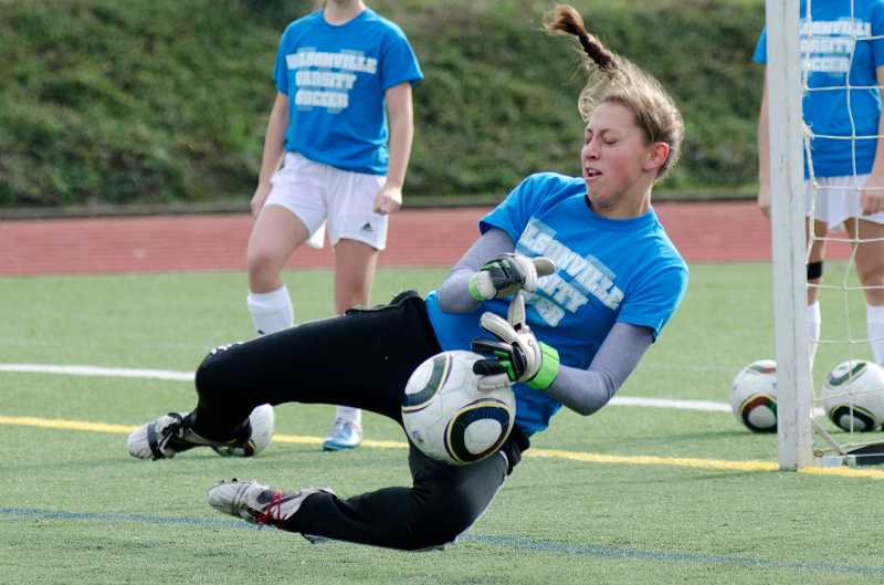 by: GREG ARTMAN - Senior goalkeeper Bess Kitzmiller will anchor the Wilsonville girls soccer team's defense this season. She was an all-league honoree last year.