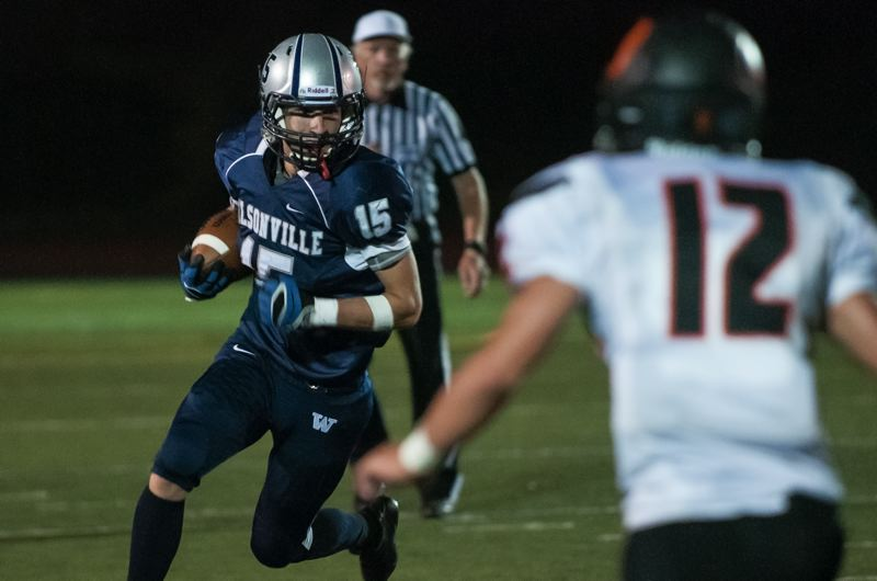 by: SPOKESMAN PHOTO: JOSH KULLA - Wilsonville senior running back Derek Sunkle racked up over 200 all purpose yards and scored two touchdowns Friday in a 23-7 win over Sprague.