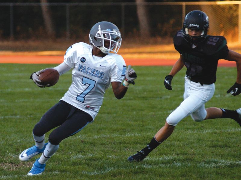 by: PAMPLIN MEDIA GROUP: DAVID BALL - Lakeridge senior Vontrell Mill cuts across the field during a kick return Friday against Reynolds.