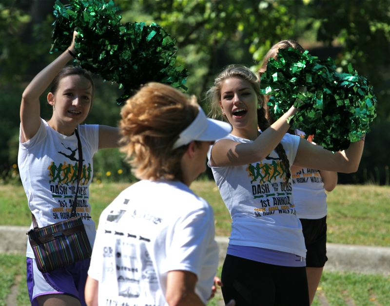 by: J. BRIAN MONIHAN - Debs cheer on runners at the finish line.