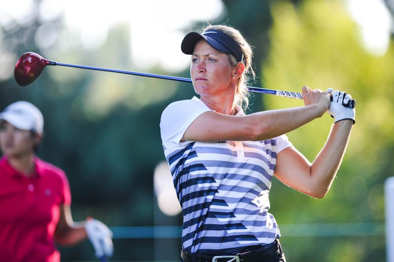 by: COURTESY OF JOHN LARIVIERE - Suzann Pettersen follows a tee shot during Sunday's final round of the LPGA Safeway Classic. She won the tournament by two shots at Columbia Edgewater Country Club.