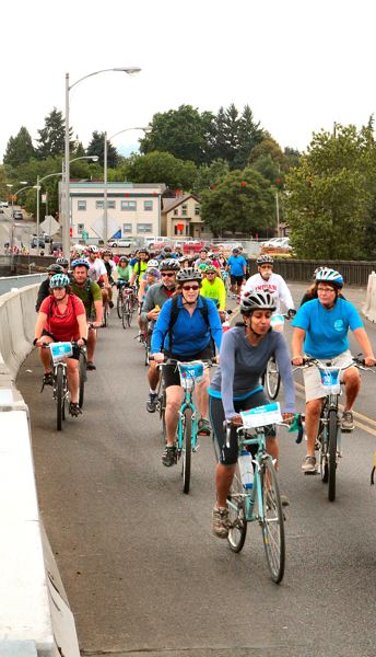 by: DAVID F. ASHTON - Providence Bridge Pedal riders navigate the new S-Curve on the recently-shifted old Sellwood Bridge.