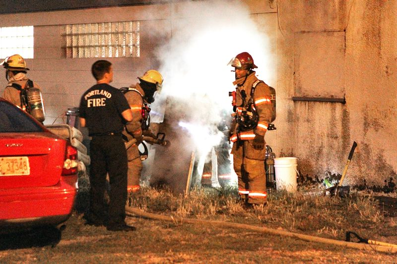 by: DAVID F. ASHTON - The Station 25 fire crew carefully moves an overheated smoke generator outside. A firefighter opens the hose nozzle, and the fire is out.