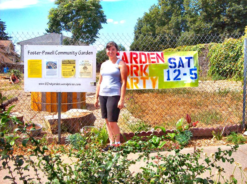 by: RITA A. LEONARD - Foster-Powell Community Garden Coordinator Vicki Wilson stands at the entrance to the neighborhoods new community garden, on ODOT property at S.E. 62nd and Powell Boulevard.