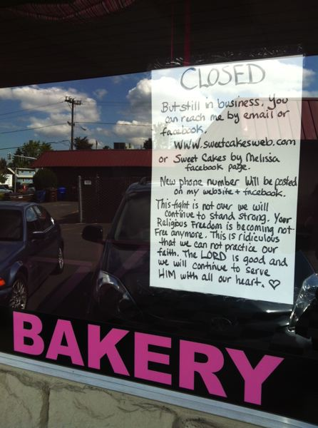 by: OUTLOOK PHOTO: LISA K. ANDERSON - Aaron and Melissa Klein taped this sign up in the window of Sweet Cakes by Melissa Saturday.