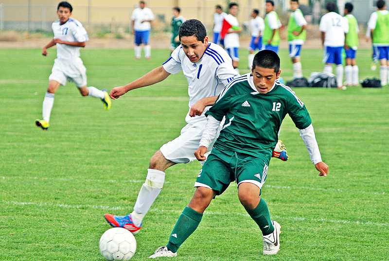by: PIONEER FILE PHOTO - Madras' Gustavo Pacheco (1) tussles with a North Marion player during a match last season. Pacheco, who started some matches as a freshman last year, will be looked upon again for significant minutes at both forward and midfield.