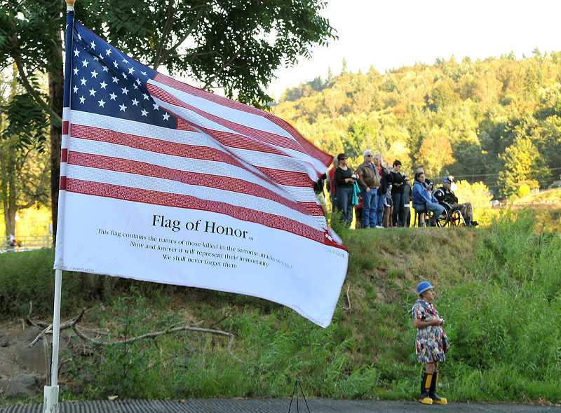 by: TIDINGS FILE PHOTO: VERN UYETAKE - The remembrance ceremony moved from the Arch Bridge to Willamette Park in 2011.