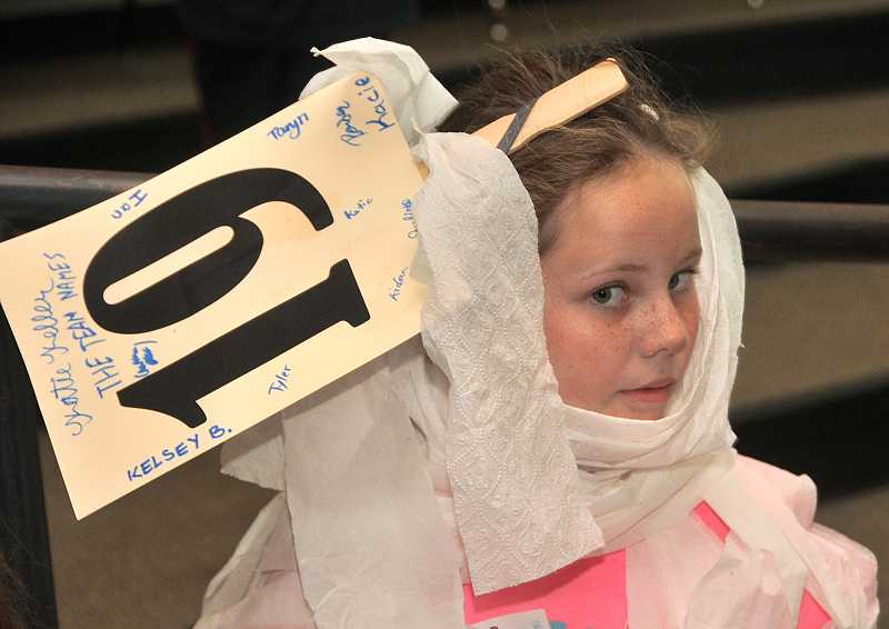 by: TIDINGS PHOTO: VERN UYETAKE - Kelsey Bjorklund takes part in a quiz while wrapped in toilet paper.
