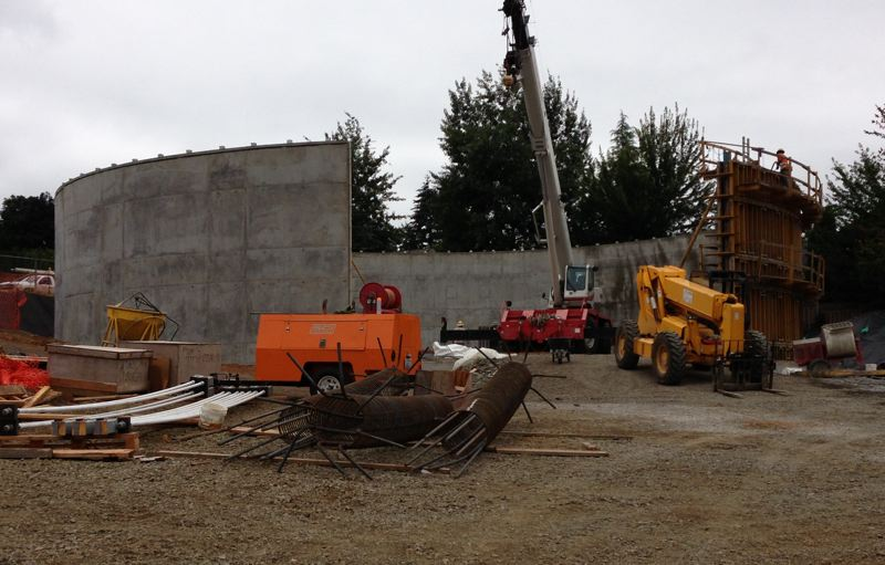 by: CONTRIBUTED PHOTO: SETH ATKINSON   - This view of the new water reservoir in Sandy will soon be closed and a roof contructed to enclose the large water tank.