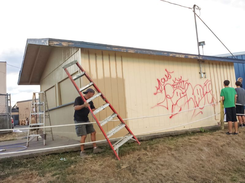 by: COURTESY PHOTO: LORI ALLEY - After Banks High Schools concession stand was hit with graffiti earlier this summer, students painted over it in time for the first football game and start of the new school year.