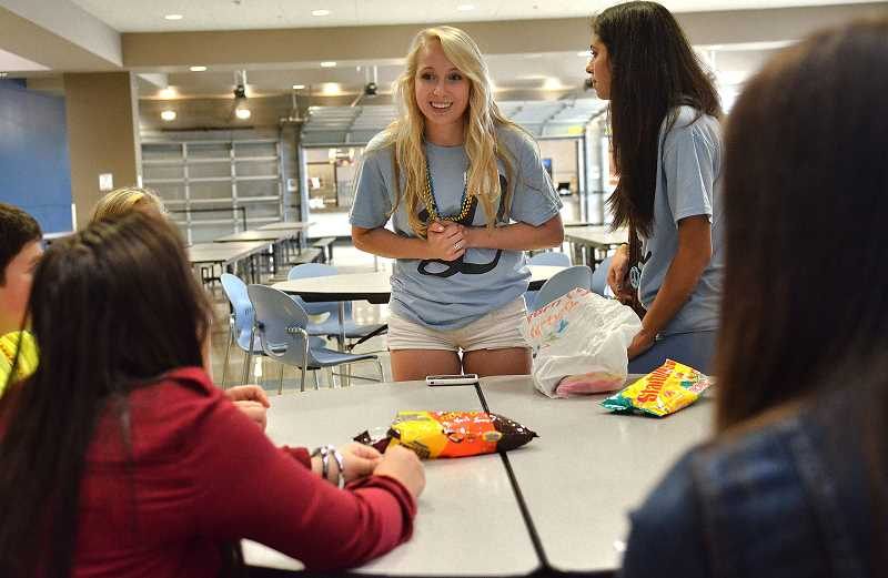 by: VERN UYETAKE - Senior Sienna Allen gives advice to incoming freshmen Tuesday morning at Lakeridge High School.