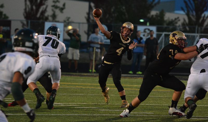by: TIMES PHOTO: MATT SINGLEDECKER - Southridge quarterback A.J. Woodin fires a ball downfield in the fourth quarter of the Skyhawks defeat to Sheldon on Friday