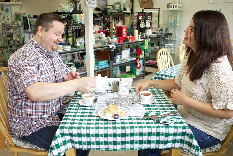 by: TIMES PHOTO: JAIME VALDEZ - Jonathan Sullivan and his wife, Nicole, enjoy a cup of  tea at their business, Forget Me Not Ireland, on Beaverton-Hillsdale Highway in Raleigh Hills