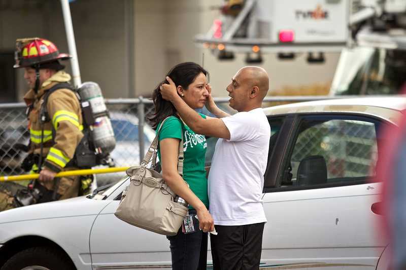 by: TIMES PHOTO: JAIME VALDEZ - Paul Singh consoles his wife, Sandeep Kaur, as they wait to find out the damage to their home at the Country Oaks Apartments. The couple lives below the apartments, which sustained heavy fire, smoke and water damage.