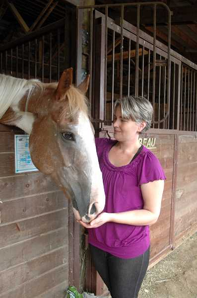 by:  ISABEL GAUTSCHI - Kat Barrett, Horse Sense Riding School founder, snuggles with Bear. The two helped each other recover from illness and neglect.