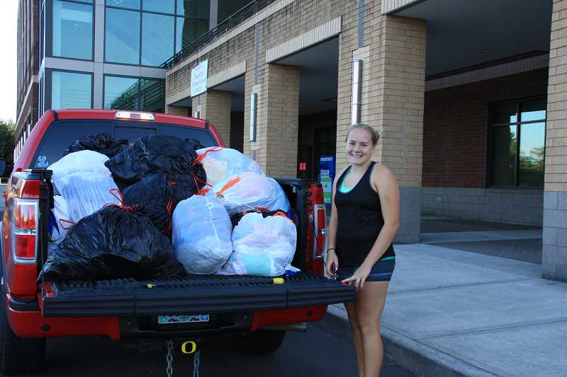 by: SUBMITTED PHOTO - Maddie Rabing, a sophomore at Lakeridge High and member of the Lake Oswego chapter of National Charity League, spearheaded a campaign to collect clothing and hygiene items for children in need.