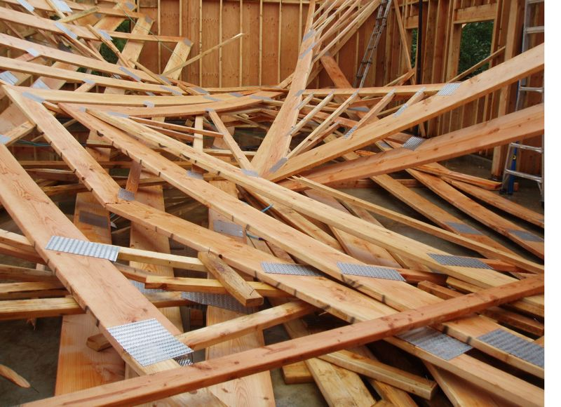 by: CONTRIBUTED PHOTO: CLACKAMAS COUNTY SHERIFFS DEPARTMENT - These are some of the roof trusses that fell on construction workers Friday afternoon, killing one man and injuring three others, one seriously.
