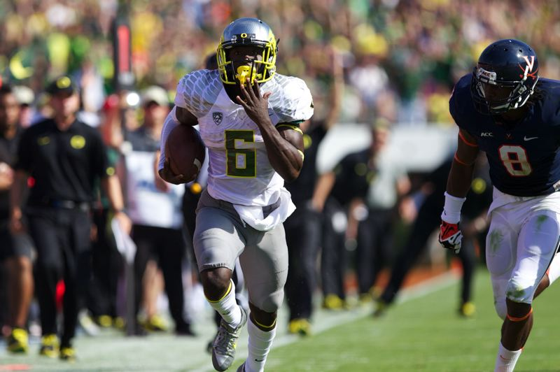 by: TRIBUNE PHOTO: JAIME VALDEZ - De'Anthony Thomas runs to daylight as the Oregon Ducks topple Virginia 59-10, raising their record to 2-0.