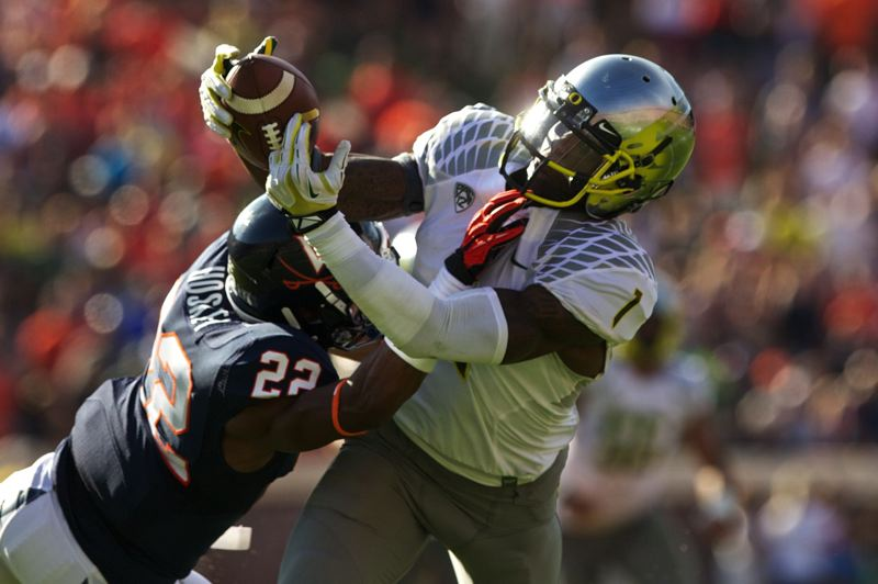 by: TRIBUNE PHOTO: JAIME VALDEZ - Oregon wide receiver Josh Huff pulls in a catch against Virginia.