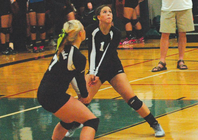 by: ESTACADA NEWS: PARKER LEE - Estacadas MacKenzie Gipple makes a pass into the front row during last weeks home win over Sandy.