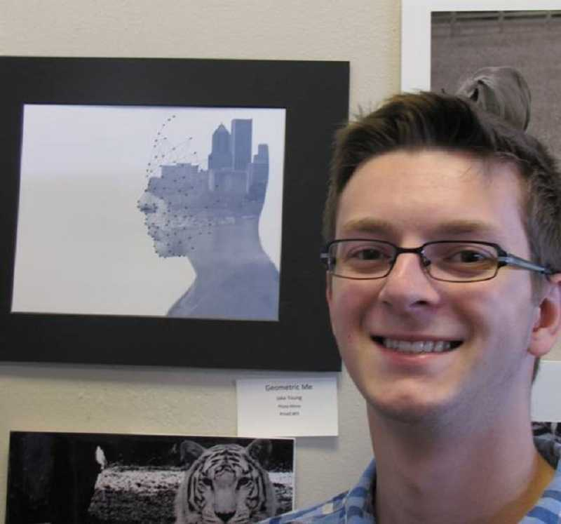 by: SUBMITTED PHOTO - Jake Young stands next to his prize-winning photo, Geometric Me.