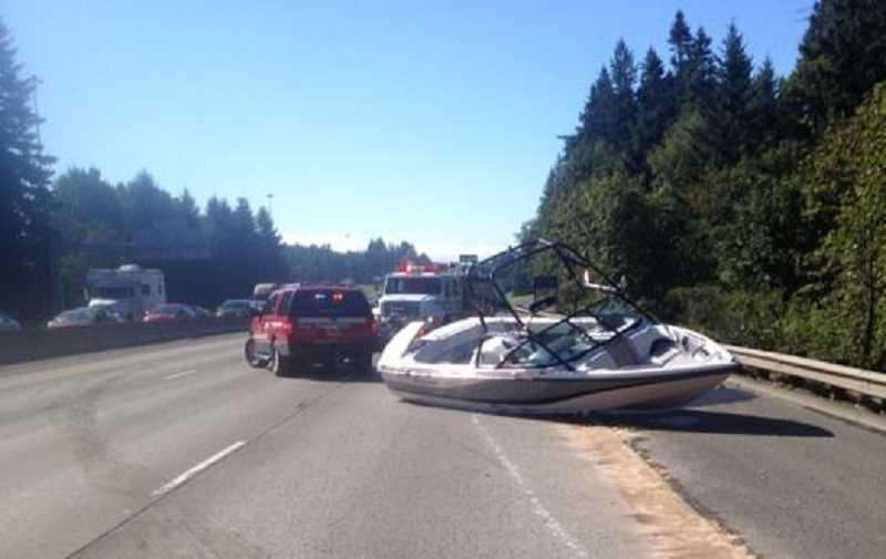 by: OREGON STATE POLICE - A boat collision with semitrailer shut down southbound Interstate 5 in Wilsonville for more than two hours Tuesday morning.