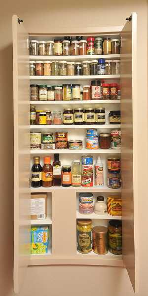 A spice cabinet was added between studs in the kitchen wall, giving plenty of storage.