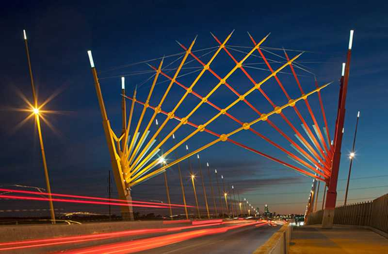 by: COURTESY PHOTO: ED CARPENTER - This glass art installation on the Broadway Viaduct in Council Bluffs, Iowa, is an example of the kind of colorful glass work that has made local artist Ed Carpenter known nationwide -- and why library patrons are excited about him bringing his glasswork here.