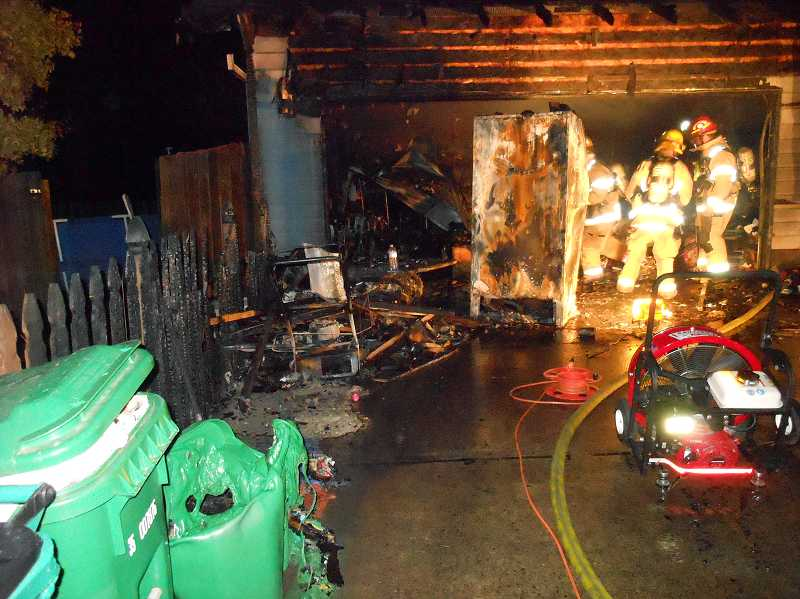 by: COURTESY PHOTO - Forest Grove firefighters fought a house fire on Alyssum Avenue last Sunday.
