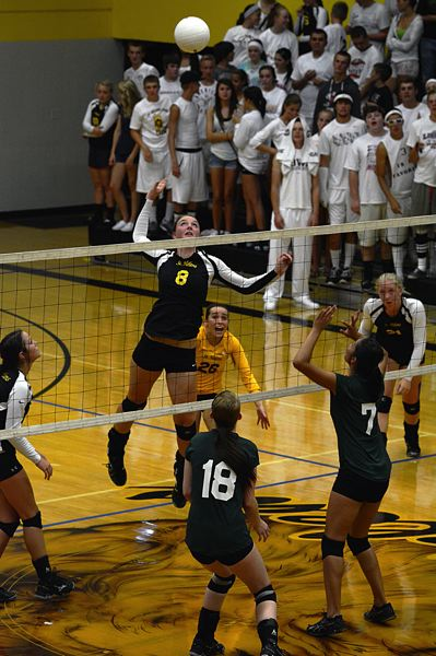 by: JOHN WILLIAM HOWARD - Taylor Albertson (8) leaps for the kill in St. Helens' Sept. 10 victory over Parkrose. The Lions defeated Parkrose in straight sets on Tuesday evening.