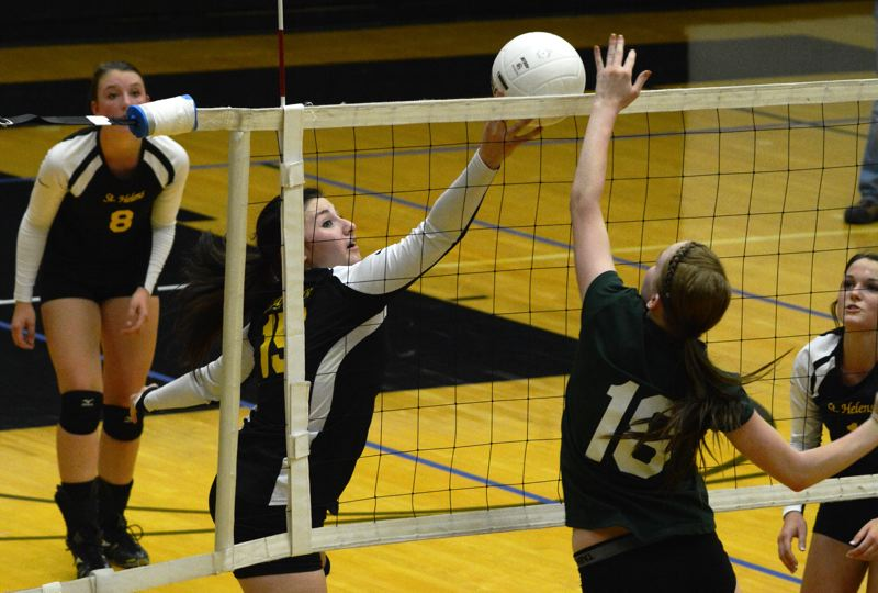 by: JOHN WILLIAM HOWARD - Senior Krista Hardy (15) attempts to tip the ball over the net. The Lions defeated Parkrose in straight sets on Tuesday, Sept. 10.