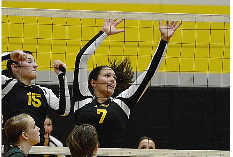 by: JOHN WILLIAM HOWARD - Senior Gabby Susee (7) jumps to block a kill attempt from Parkrose. Susee dominated the match, which St. Helens won in straight sets on Tuesday, Sept. 10.