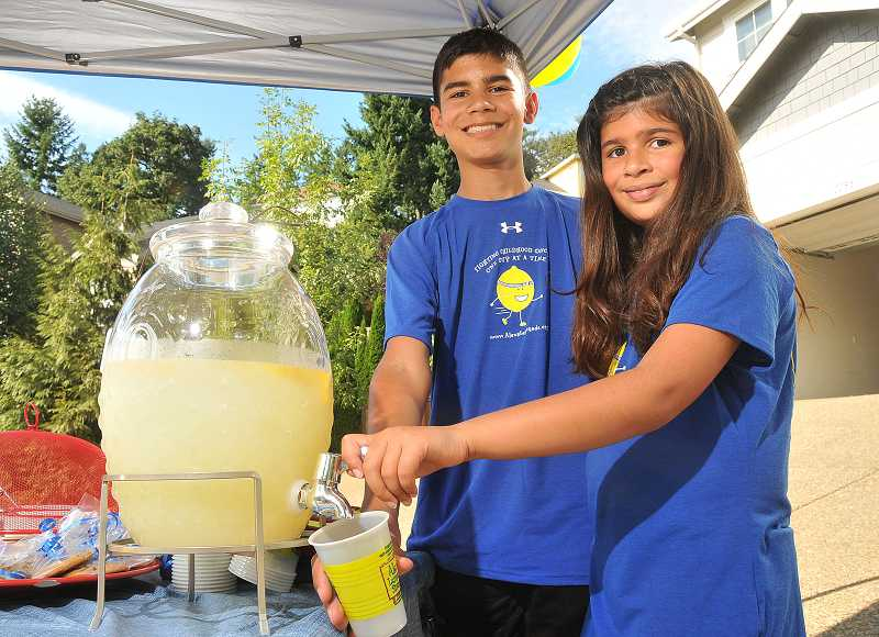 by: TIDINGS PHOTO: VERN UYETAKE - Logan and Karina Rower serve lemonade on Aug. 27 to raise money for childhood cancer research.