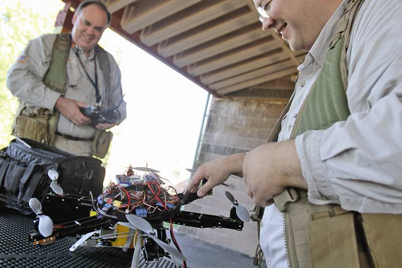 by: TIMES PHOTO: JONATHAN HOUSE - Rather than buy a drone, Patrick Sherman and Brian Zvaigzne of Tigard decided to make their own.