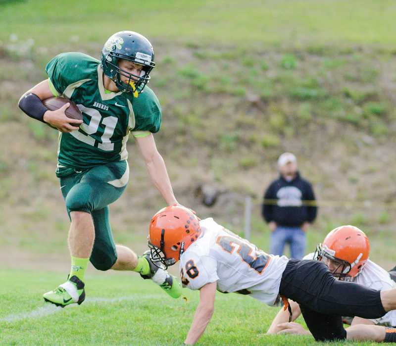by: NEWS-TIMES PHOTO: CHASE ALLGOOD - Gaston senior running  back Austin Morey sprints past a diving Willamina defender during last Friday's non-league football game.