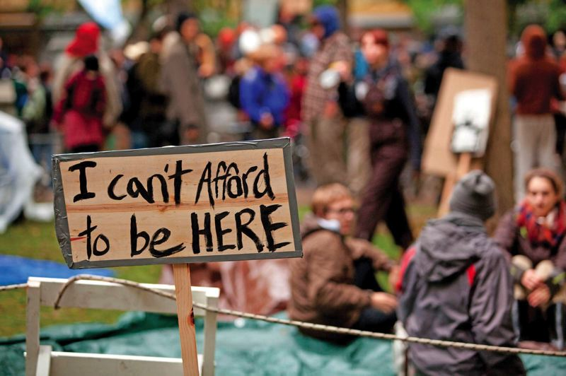 by: TRIBUNE FILE PHOTO: CHRISTOPHER ONSTOTT - Campers with Occupy Portland took up residence in Chapman Square in October 2011. Two years later, the loosely organized movement is handing out ID cards to distinguish its protesters from homeless people.