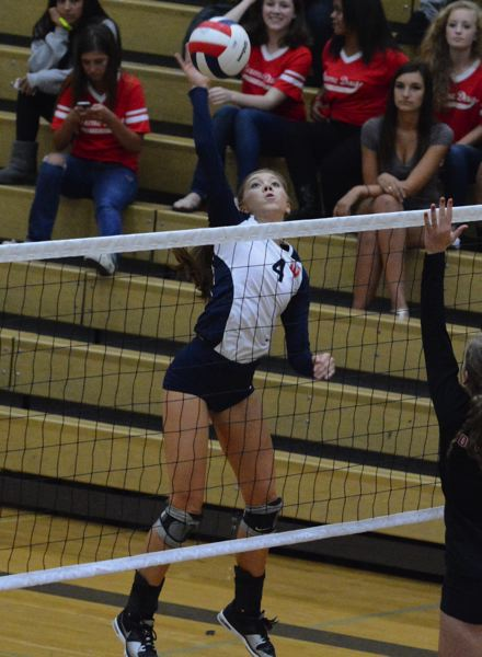 by: TIMES PHOTO: MATT SINGLEDECKER - Westview senior Katrina Dubsky flies high above the net for a kill against Oregon City.