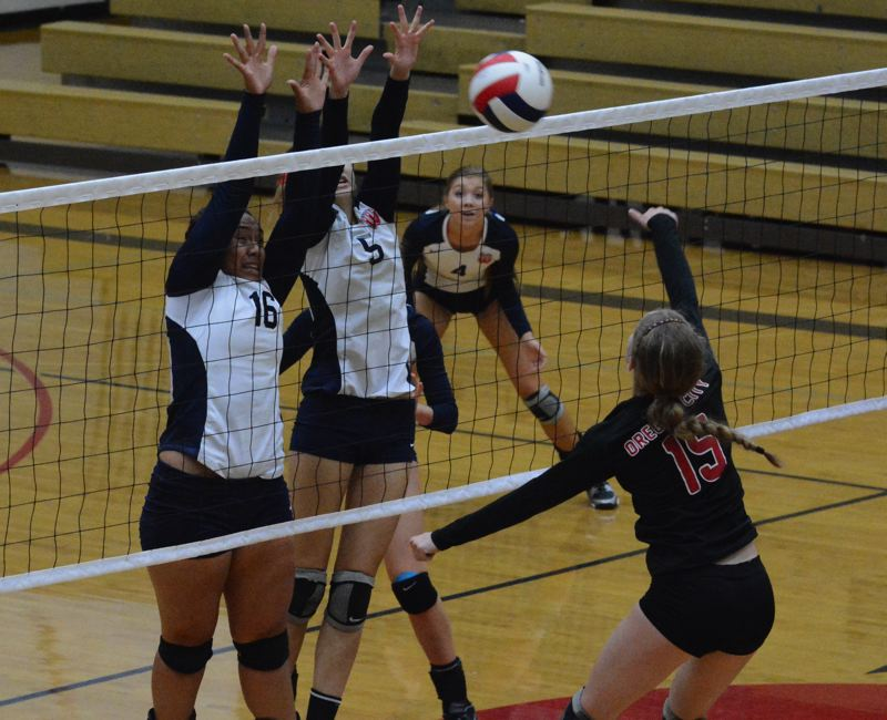 by: TIMES PHOTO: MATT SINGLEDECKER - Westviews Jodeci Afo-Tuia and Abby Lautenbach go up together for a double-team block versus Oregon City.