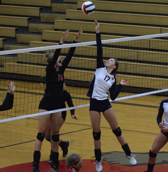 by: TIMES PHOTO: MATT SINGLEDECKER - Westviews Marissa Kolb goes up for a block in the second set of the Wildcats loss to Oregon City.