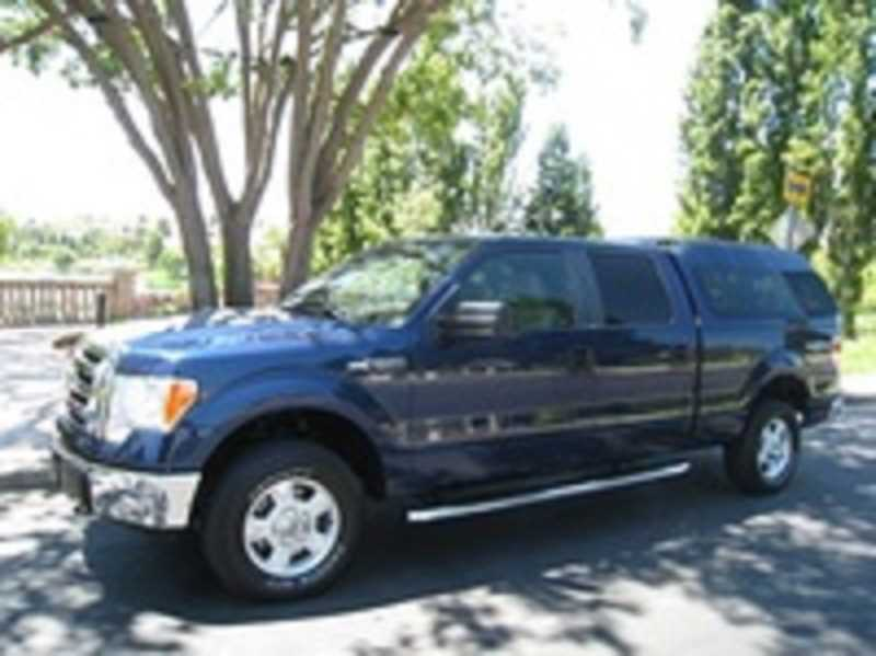 by: CLACKAMAS COUNTY SHERIFFS OFFICE - A Woodburn mans 2013 Ford F-150 and a red-and-black motorized wheelchair inside, were stolen from his home Tuesday. This is a similar-looking truck to Madsens.