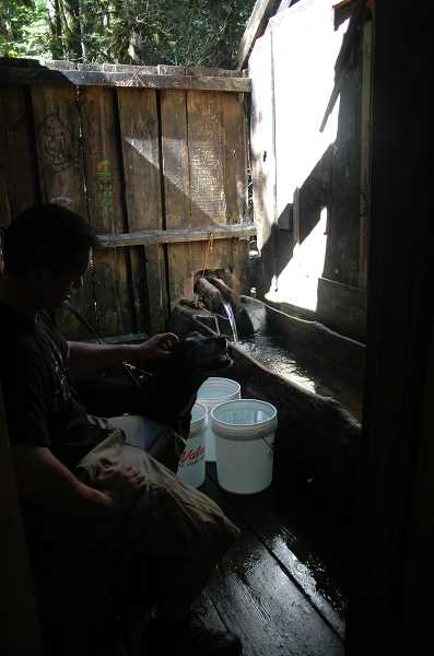 by:  ISABEL GAUTSCHI - A Bagby visitor relaxes with his dog as the tub fills.
