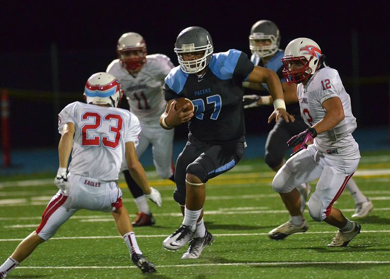 by: VERN UYETAKE - Lakeridge runningback Lopeti Aisea had a breakout performance against Centennial, rushing for 205 yards on eight carries.