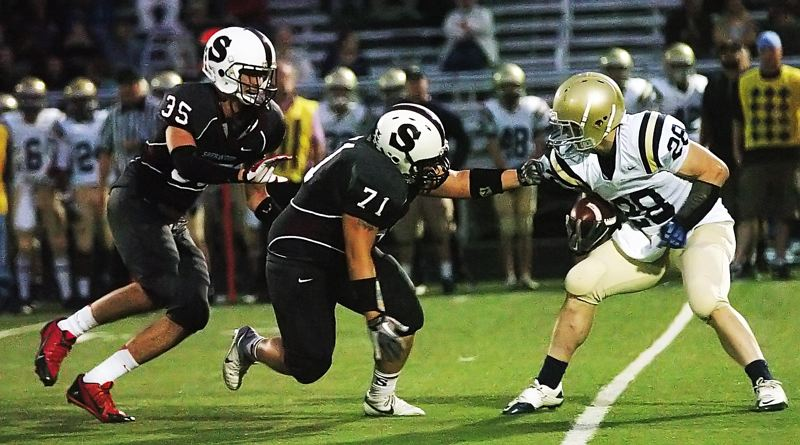 by: DAN BROOD - NO WHERE TO GO -- Sherwood seniors Jordan Kurahara (35) and Martin Layna chase down West Albany's Jake LaCoste.