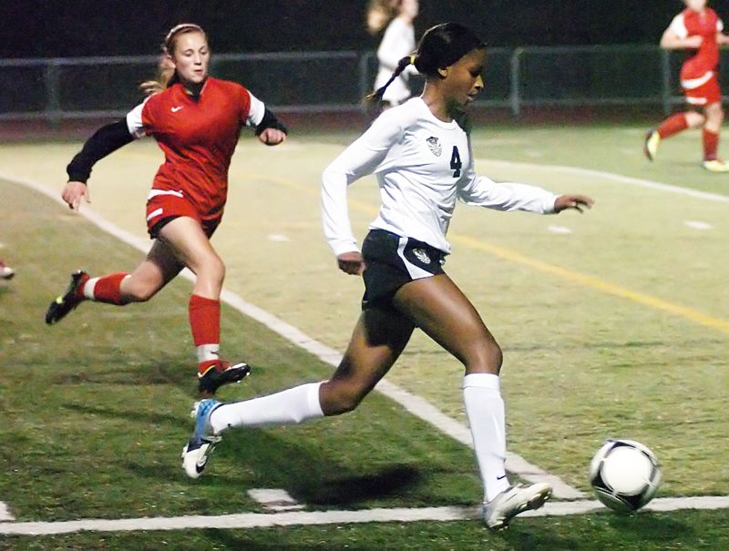 by: DAN BROOD - MOVING FAST -- Tualatin defender Aryana Harvey quickly gets the ball upfield in a state playoff match last year.