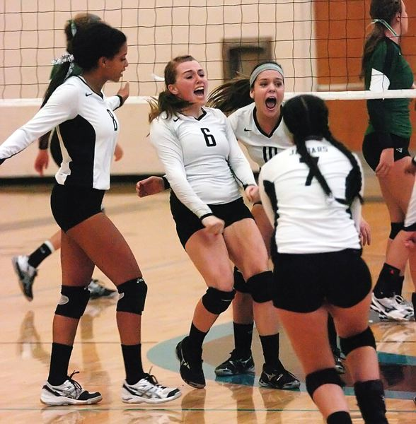 by: PAMPLIN MEDIA GROUP PHOTO: DAN BROOD - Century junior Amber O'Connor (6) celebrates with her teammates after scoring a point in last Thursday's match.