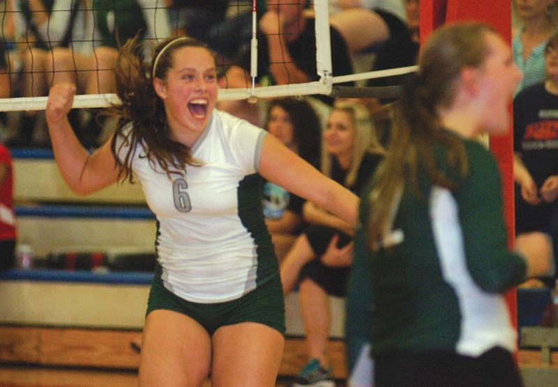 by: THE OUTLOOK: DAVID BALL - Reynolds setter Kadyn Jones celebrates a point during Thursdays sweep at Centennial.