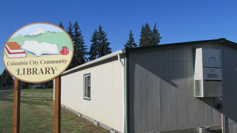 by: SPOTLIGHT PHOTO: MARK MILLER - The temporary home of the Columbia City Community Library: a modular building on Second Street provided by the St. Helens School District.